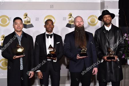"Jonathan Yip, Ray Romulus, Jeremy Reeves, Ray Charles McCullough II. Jonathan Yip, left, Ray Romulus, Jeremy Reeves, and Ray Charles McCullough II of The Stereotypes, pose with the best R&B song award for ""That's What I Like"" in the press room at the 60th annual Grammy Awards at Madison Square Garden, in New York"