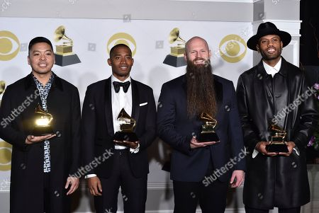 """Jonathan Yip, Ray Romulus, Jeremy Reeves, Ray Charles McCullough II. Jonathan Yip, left, Ray Romulus, Jeremy Reeves, and Ray Charles McCullough II of The Stereotypes, pose with the best R&B song award for """"That's What I Like"""" in the press room at the 60th annual Grammy Awards at Madison Square Garden, in New York"""