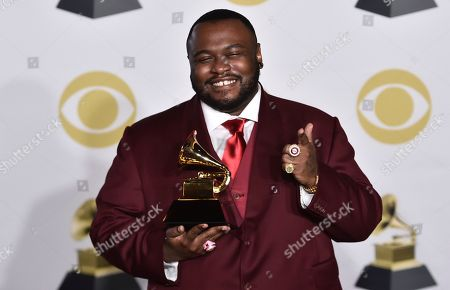 James Fauntleroy, poses with the best R&B song award for 'That's What I Like' in the press room at the 60th annual Grammy Awards at Madison Square Garden, in New York