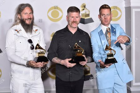 "Troy Sanders, Bill Kelliher, Brann Dailor. Troy Sanders, from left, Bill Kelliher and Brann Dailor of Mastodon pose in the press room with the best metal performance award for ""Sultan's Curse"" at the 60th annual Grammy Awards at Madison Square Garden, in New York"
