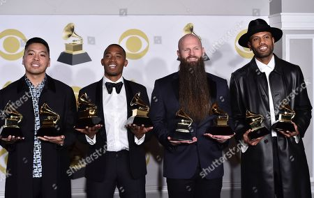 """Stock Picture of Jonathan Yip, Romulus, Jeremy Reeves, Ray Charles McCullough II, The Stereotypes. Jonathan Yip, left, Ray Romulus, Jeremy Reeves and Ray Charles McCullough II, of The Stereotypes, pose with the best R&B song and song of the year awards for """"That's What I Like"""" in the press room at the 60th annual Grammy Awards at Madison Square Garden, in New York"""