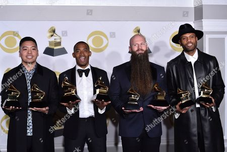 """Stock Image of Jonathan Yip, Romulus, Jeremy Reeves, Ray Charles McCullough II, The Stereotypes. Jonathan Yip, left, Ray Romulus, Jeremy Reeves and Ray Charles McCullough II, of The Stereotypes, pose with the best R&B song award for """"That's What I Like"""" in the press room at the 60th annual Grammy Awards at Madison Square Garden, in New York"""