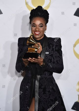 """Kristolyn Lloyd poses with the best musical theater album award for """"Dear Evan Hansen"""" in the press room at the 60th annual Grammy Awards at Madison Square Garden, in New York"""