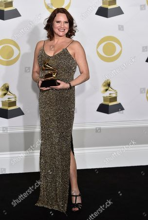 """Jennifer Laura Thompson poses with the best musical theater album award for """"Dear Evan Hansen"""" in the press room at the 60th annual Grammy Awards at Madison Square Garden, in New York"""