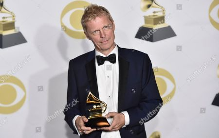 """Marius de Vries poses in the press room with the best compilation soundtrack for Visual media award for """"La La Land"""" at the 60th annual Grammy Awards at Madison Square Garden, in New York"""