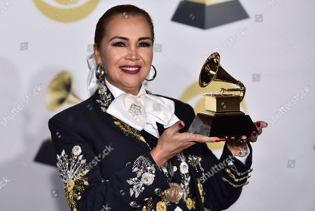 """Aida Cuevas poses in the press room with the best regional Mexican music album (Including Tejano) award for """"Arriero Somos Versiones Acusticas"""" at the 60th annual Grammy Awards at Madison Square Garden, in New York"""