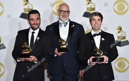 """Lawrence Azerrad, David Pescovitz, Timothy Daly. Lawrence Azerrad, from left, David Pescovitz, center, and Timothy Daly pose in the press room with the best boxed or special limited edition package award for """"The Voyager Golden Record: 40th Anniversary Edition"""" at the 60th annual Grammy Awards at Madison Square Garden, in New York"""