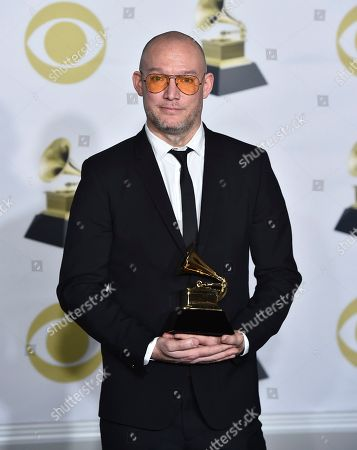 """Stock Photo of Scott Devendorf, of The National, poses with the best alternative music album award for """"Sleep Well Beast"""" in the press room at the 60th annual Grammy Awards at Madison Square Garden, in New York"""