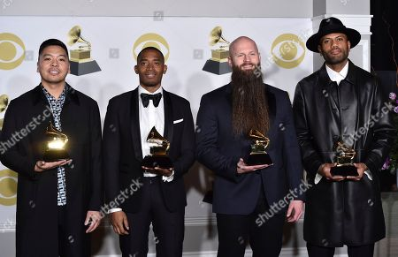 """Stock Photo of Jonathan Yip, Ray Romulus, Jeremy Reeves, Ray Charles McCullough II. Jonathan Yip, from left, Ray Romulus, Jeremy Reeves, and Ray Charles McCullough II of The Stereotypes, pose with the best R&B song award for """"That's What I Like"""" in the press room at the 60th annual Grammy Awards at Madison Square Garden, in New York"""