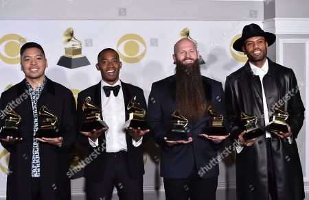 "Jonathan Yip, Romulus, Jeremy Reeves, Ray Charles McCullough II. Jonathan Yip, left, Ray Romulus, Jeremy Reeves and Ray Charles McCullough II, of The Stereotypes, pose with the best R&B song and song of the year awards for ""That's What I Like"" in the press room at the 60th annual Grammy Awards at Madison Square Garden, in New York"
