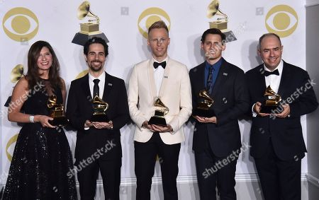 """Stacey Mindich, Alex Lacamoire, Justin Paul, Benj Pasek, Pete Ganbarg. Stacey Mindich, from left, Alex Lacamoire, Justin Paul, Benj Pasek, Pete Ganbarg pose in the press room with the best musical theater album award for """"Dear Evan Hansen"""" at the 60th annual Grammy Awards at Madison Square Garden, in New York"""