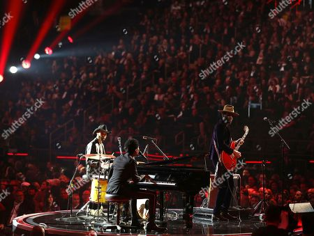 Joe Saylor, Jon Batiste, Gary Clark Jr. Joe Saylor, from left, Jon Batiste and Gary Clark Jr. perform a tribute to Chuck Berry and Fats Domino at the 60th annual Grammy Awards at Madison Square Garden, in New York