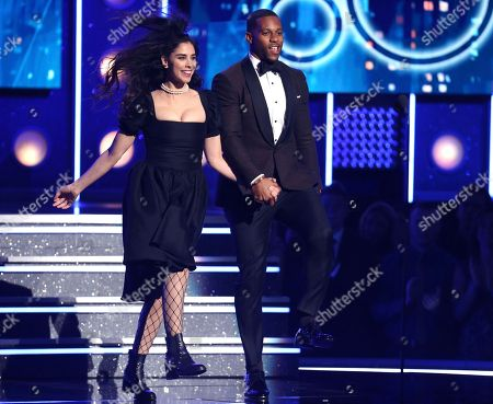 Sarah Silverman, Victor Cruz. Sarah Silverman, left, and Victor Cruz introduce a performance by Luis Fonsi, Daddy Yankee and Zuleyka Rivera at the 60th annual Grammy Awards at Madison Square Garden, in New York