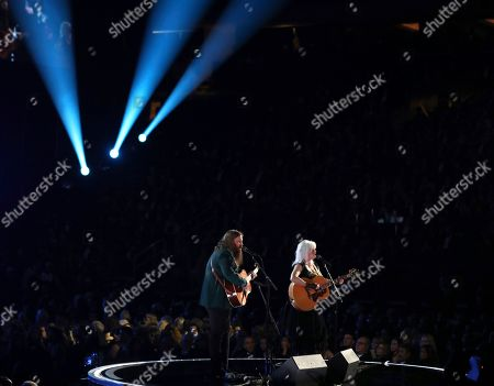"Chris Stapleton, Emmylou Harris. Chris Stapleton and Emmylou Harris perform ""Wildflowers"" during an In Memoriam tribute to Tom Petty at the 60th annual Grammy Awards at Madison Square Garden, in New York"