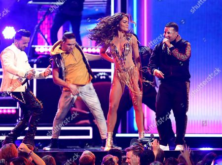 """Luis Fonsi, Zuleyka Rivera, Daddy Yankee. Luis Fonsi, background left, and Daddy Yankee, right, perform """"Despacito"""" as Zuleyka Rivera, second right, dances at the 60th annual Grammy Awards at Madison Square Garden, in New York"""