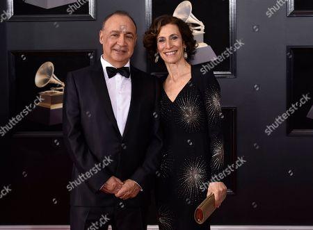 Len Blavatnik, Emily Appelson. Len Blavatnik, left, and Emily Appelson arrive at the 60th annual Grammy Awards at Madison Square Garden, in New York