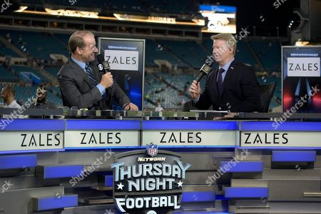 """Bill Cowher, Phil Simms. Thursday Night Football sportscasters Bill Cowher, left, and Phil Simms broadcast from the set on the field before an NFL football game between the Jacksonville Jaguars and the Tennessee Titans in Jacksonville, Fla. The NFL has picked Twitter to stream its Thursday night games. When the league negotiated its latest deal for Thursdays, it decided to sell the streaming rights separately for an """"over the top"""" broadcast"""