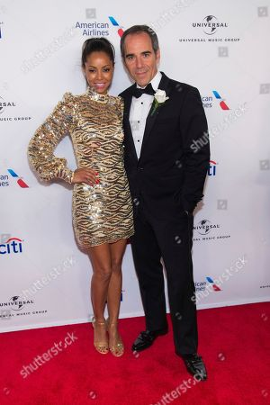 Angelina Davis, Monte Lipman. Angelina Davis, left, and Republic Records Chairman/CEO Monte Lipman attend the Universal Music Group's Grammy after party at Spring Studios, in New York