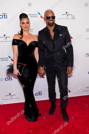 Stock Picture of Anabelle Acosta, Shemar Moore. Anabelle Acosta, left, and Shemar Moore attend the Universal Music Group's Grammy after party at Spring Studios, in New York