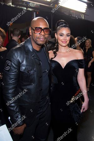 Dave Chappelle, Anabelle Acosta. Dave Chappelle, left, and Anabelle Acosta attend the Universal Music Group's Grammy after party at Spring Studios, in New York