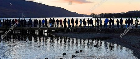 50th Anniversary Of The Death Of Donald CaMPbell On Coniston Water Coniston Cumbria.- People Wait For A Jet Flypast Which Didn't Happen At 8.47am This Morning To Commemorate Donald CaMPbell Who Died On Jan 4th 1967 AtteMPting To Break The World Water Speed Record.Witherow - 4/1/17.