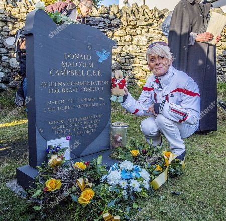 50th Anniversary Of The Death Of Donald CaMPbell On Coniston Water.- Gina CaMPbell (in White) Places Flowers And 'mr Whoppit' (donald's Mascot) At The Grave Of Her Father Donald CaMPbell Who Died On Jan 4th 1967 AtteMPting To Break The World Water Speed Record.Witherow - 4/1/17.