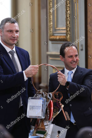 """The Mayor of Kiev Vitali Klitschko (L) handovers the Host City Insignia to his Lisbon counterpart Fernando Medina (R) during the Semi-Final Allocation Draw Semi-Finals of the Eurovision Song Contest 2018, at the City Hall of Lisbon, Portugal, 29 of January 2018. During the Semi-Final Allocation Draw, the countries that will take part in the Semi-Finals are divided into pots, based on historic voting patterns. In this way, countries that traditionally award each other points are less likely to end up in the same Semi-Final, adding excitement to the shows. The pots are approved by the contest's Executive Supervisor on behalf of the European Broadcasting Union (EBU) and the Chairman of the Reference Group, the contest's governing body on behalf of all Participating Broadcasters. Eurovision Song Contest 2018 will take place in Lisbon in May 2018. Portugal participated in has winner of the Eurovision Song Contest 2017 contest in Kiev, Ukraine, with the song """"Amar pelos dois"""", written by Luisa Sobral and performed by her brother Salvador Sobral."""