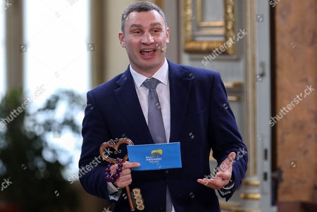 """The Mayor of Kiev Vitali Klitschko holds the Host City Insignia during his speech before the handover ceremony to his Lisbon counterpart Fernando Medina during the Semi-Final Allocation Draw Semi-Finals of the Eurovision Song Contest 2018, at the City Hall of Lisbon, Portugal, 29 of January 2018.  During the Semi-Final Allocation Draw, the countries that will take part in the Semi-Finals are divided into pots, based on historic voting patterns. In this way, countries that traditionally award each other points are less likely to end up in the same Semi-Final, adding excitement to the shows. The pots are approved by the contest's Executive Supervisor on behalf of the European Broadcasting Union (EBU) and the Chairman of the Reference Group, the contest's governing body on behalf of all Participating Broadcasters. Eurovision Song Contest 2018 will take place in Lisbon in May 2018. Portugal participated in has winner of the Eurovision Song Contest 2017 contest in Kiev, Ukraine, with the song """"Amar pelos dois"""", written by Luisa Sobral and performed by her brother Salvador Sobral."""
