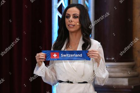 Presenters Filomena Cautela draws the Switzerland card during the Eurovision Song Contest semifinal allocation draw, at the Lisbon City Hall. The semifinal allocation draw determines which country will participate in which semifinal of the 2018 Eurovision Song Contest to be held in Lisbon in May 2018