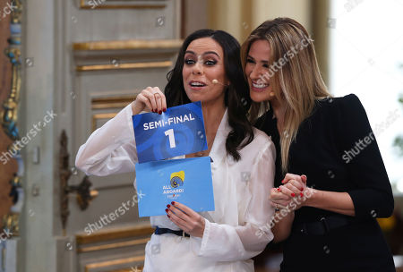 Presenters Filomena Cautela, left, and Silvia Alberto draw a card during the Eurovision Song Contest semifinal allocation draw, at the Lisbon City Hall. The semifinal allocation draw determines which country will participate in which semifinal of the 2018 Eurovision Song Contest to be held in Lisbon in May 2018