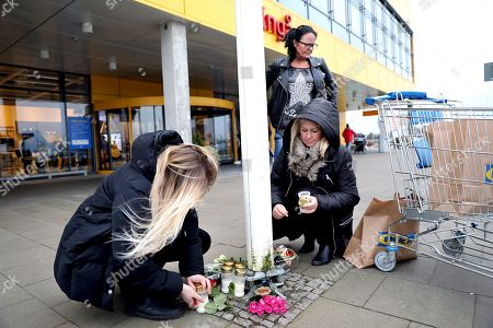 Employees leave tributes outside the IKEA in Älmhult
