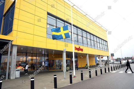 Stock Image of Flag on half mast outside IKEA Älmhult, Sweden, after the death of IKEA founder Ingvar Kamprad
