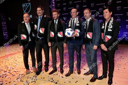 David Beckham, Jorge Mas, Jose Mas, Simon Fuller, Don Garber. David Beckham, third from left, poses for a group photo at an event where it was announced that Major League Soccer is bringing an expansion team to Miami, in Miami. From left to right are Jorge Mas, Marcelo Claure, Beckham, MLS Commissioner Don Garber, Jose Mas, and Simon Fuller
