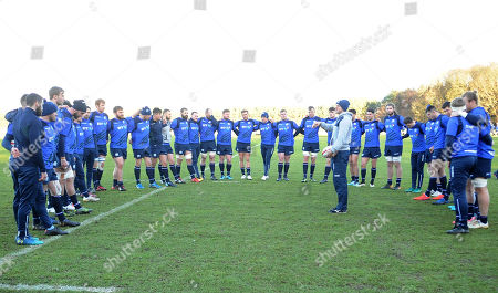 Scotland players listen to instructions from Mark Robertson Scotland strength & conditiong coach at the start of the session.