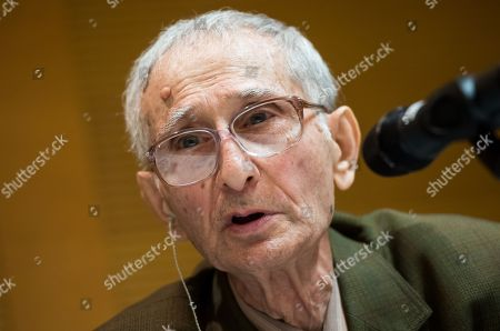 Stock Photo of Concentration camp survivor Volodymyr Iwanowitsch Dshelali speaks during a contemporary witness talk in in the context of the International Youth Meeting of the Bundestag at the Max Mannheimer Studienzentrum in Dachau near Munich, Bavaria, Germany, 29 January 2018. Eighty young people, who deal with the history of National Socialism or who are committed to combating anti-Semitism and racism, took part in the Bundestag's International Youth Meeting this year. They dealt in particular with the fates of people who resisted National Socialism for reasons of conscience.