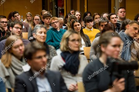 Stock Picture of People listen to concentration camp survivor Volodymyr Iwanowitsch Dshelali during a contemporary witness talk in in the context of the International Youth Meeting of the Bundestag at the Max Mannheimer Studienzentrum in Dachau near Munich, Bavaria, Germany, 29 January 2018. Eighty young people, who deal with the history of National Socialism or who are committed to combating anti-Semitism and racism, took part in the Bundestag's International Youth Meeting this year. They dealt in particular with the fates of people who resisted National Socialism for reasons of conscience.