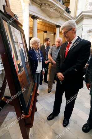 Robbie Boyd, Phil Bryant. Mississippi Gov. Phil Bryant, right, inspects the portrait of the late Gov. Bill Allain, after its unveiling, at the Capitol in Jackson, Miss. The portrait artist Robbie Boyd, center, watches the inspection