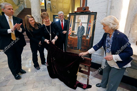 Stock Photo of Robbie Boyd, Charlene Combest, Brandon Presley, Megan Holeman, Phil Bryant. Portrait artist Robbie Boyd, right, and Charlene Combest, niece of the late Gov. Bill Allain, unveil Boyd's portrait of the governor standing in his office, during ceremonies at the Capitol in Jackson, Miss. Allain was governor from 1984 to 1988 and shunned attention after he left office. He died in December of 2013, requiring Boyd to paint the portrait from photographs. Witnessing the unveiling were Northern District Public Service Commissioner Brandon Presley, Megan Holeman, Allain's grand niece, and Gov. Phil Bryant, standing next to the portrait