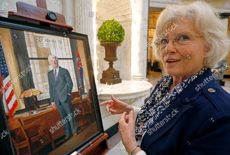 Portrait artist Robbie Boyd of Pontotoc, speaks about her portrait of the late Gov. Bill Allain, after its unveiling, at the Capitol in Jackson, Miss. Allain was governor from 1984 to 1988 and shunned attention after he left office. He died in December of 2013, requiring Boyd to paint the portrait from photographs