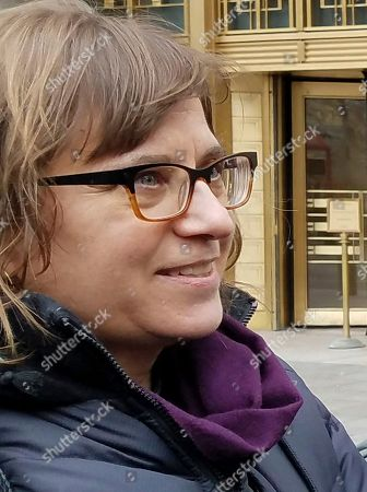 """Amy Gottlieb, wife of jailed immigrant rights activist Ravi Ragbir, stands outside federal court in New York, after a federal judge ordered Ragbir's immediate release from prison. U.S. District Judge Katherine B. Forrest ordered his immediate release Monday and said people subject to deportation deserve """"the freedom to say goodbye"""