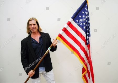 Released by U.S. Citizenship and Immigration Services (USCIS), model Fabio poses during a naturalization ceremony at the Los Angeles Convention Center in Los Angeles. Fabio, real name Fabio Lanzoni, the long-locked blonde Italian who became a cultural phenomenon in the 1990s, became a naturalized American citizen on Wednesday