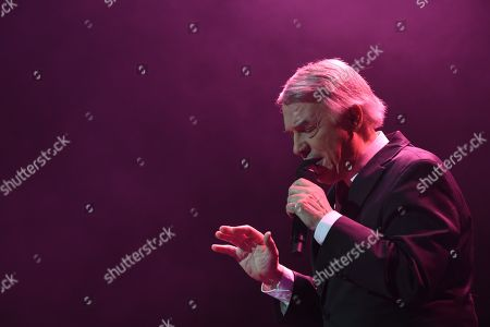 Stock Photo of Belgian-Italian singer Salvatore Adamo during his concert at Nuevo Apolo theater