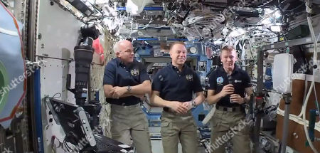 In this image made from video provided by NASA, from left, NASA astronauts Jeffrey Williams and Timothy Kopra, and British astronaut Timothy Peake participate in an interview from the International Space Station on . Peake, Britain's first official spaceman, says he's ready to run the London Marathon in 1 1/2 weeks - from 250 miles up