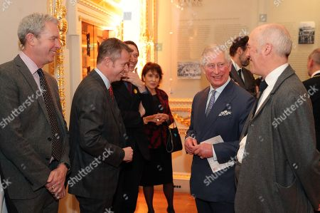Prince Charles is joined by Charles Saumarez Smith (right) secretary and chief executive of the Royal Academy, as they meet directors of various institutes who have loaned art for the exhibition 'Charles I: King and Collector' exhibition