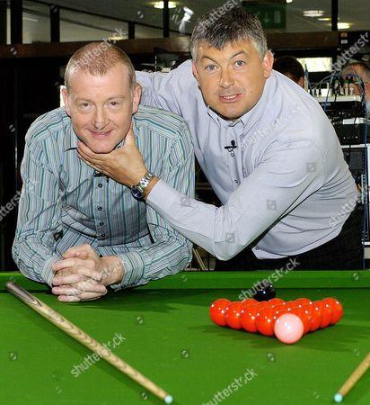 John Parrott And Steve Davis Pictured Having Fun Beside A Snooker Table.