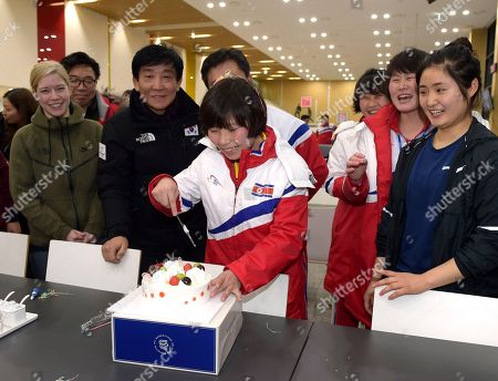 Choe Un Kyung, Sarah Murray. Provided by Korean Sports & Olympic Committee, North Korean women's hockey player Choe Un Kyung, cuts a cake as South and North Korean teammates celebrate her birthday at the Jincheon National Training Center in Jincheon, South Korea. On Tuesday, Jan. 30, 2018, South Korea expressed regret over North Korea's cancellation of one of the joint cooperation projects planned for next month's Winter Olympics, a development highlighting the delicate nature of ties between the rivals split for seven decades. At left is their head coach Sarah Murray