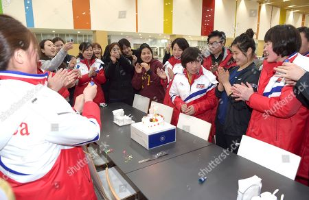 Provided by Korean Sports & Olympic Committee, North Korean women's hockey player Choe Un Kyung, third from right, is celebrated her birthday by South and North Korean teammates at the Jincheon National Training Center in Jincheon, South Korea. On Tuesday, Jan. 30, 2018, South Korea expressed regret over North Korea's cancellation of one of the joint cooperation projects planned for next month's Winter Olympics, a development highlighting the delicate nature of ties between the rivals split for seven decades. At left is their head coach Sarah Murray