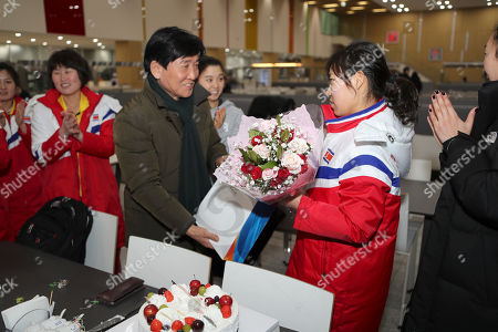 Jin Ok, Lee Jae-geun. Provided by Korean Sports & Olympic Committee, Lee Jae-geun, center, head of the South Korea's Jincheon National Training Center, gives presents to North Korean women's hockey player Jin Ok to celebrate her birthday at the center in Jincheon, South Korea. On Tuesday, Jan. 30, 2018, South Korea expressed regret over North Korea's cancellation of one of the joint cooperation projects planned for next month's Winter Olympics, a development highlighting the delicate nature of ties between the rivals split for seven decades. At left is their head coach Sarah Murray