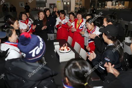 Provided by Korean Sports & Olympic Committee, North Korean women's hockey player Jin Ok, third from right, is celebrated her birthday by her South and North Korean teammates at the Jincheon National Training Center in Jincheon, South Korea. On Tuesday, Jan. 30, 2018, South Korea expressed regret over North Korea's cancellation of one of the joint cooperation projects planned for next month's Winter Olympics, a development highlighting the delicate nature of ties between the rivals split for seven decades. At left is their head coach Sarah Murray