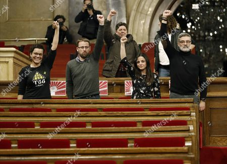 (L-R) Extreme left wing pro-independence Popular Unity Candidacy (CUP) party's Members of Parliament Natalia Sanchez, Vidal Aragones, Maria Sirvent and Carles Riera attend a protest against the decision to postpone investiture of Catalonian regional President at the plenary session room of the Catalan Parliament in Barcelona, Spain, 30 January 2018. The investiture of the regional President was postponed earlier today by Speaker of the Catalan Parliament, Roger Torrent, in order to give time for the Constitutional Court to study Catalonia's fugitive former President Carles Puigdemont's request to be elected President abroad. Last 27 January 2018, the Constitutional Court announced that Carles Puigdemont must return to Spain if he wants to be elected in the investiture debate.The Court also recalled that Puigdemont would need a judicial permission, despite his presence at the Chamber, as there is still a warrant order in force.
